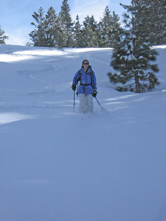 Image of skier descending ski run in fresh powder